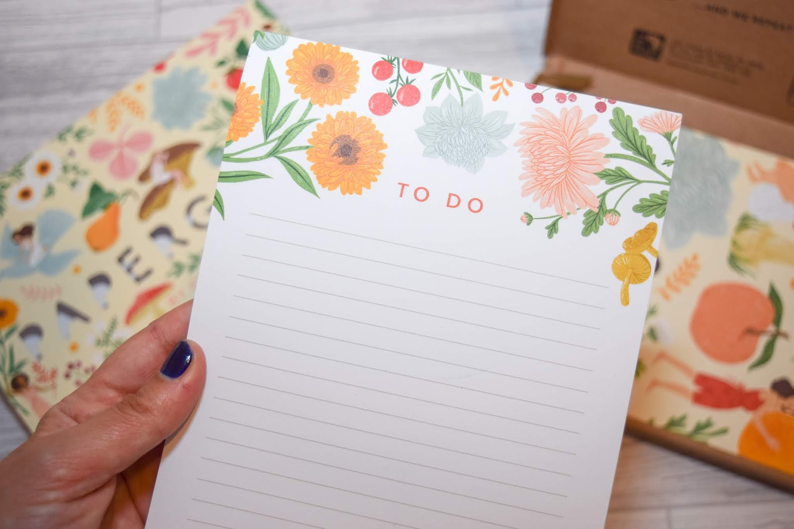 An A5 to-do list pad with a floral pattern on the top and lines to write on underneath.