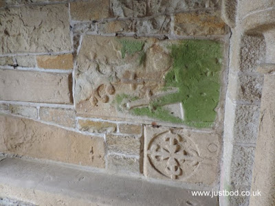 Carved fragments in wall Church of St John the Baptist, Stanwick, North Yorkshire