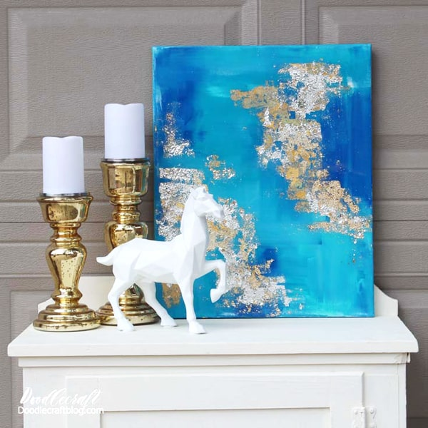Acrylic painting abstract art in various shades of blue with gold and silver leaf. Coated with a layer of high gloss resin for a perfect professional finish.