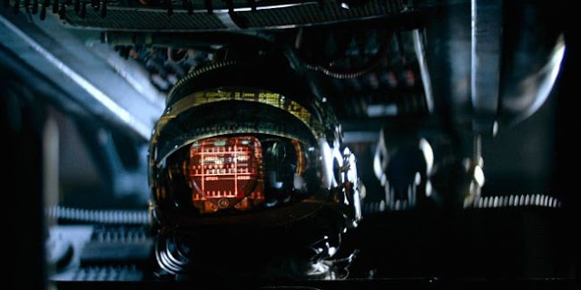 Computer readout reflected in a space helmet in Alien