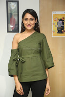 Pragya Jaiswal in a single Sleeves Off Shoulder Green Top Black Leggings promoting JJN Movie at Radio City 10.08.2017 076.JPG