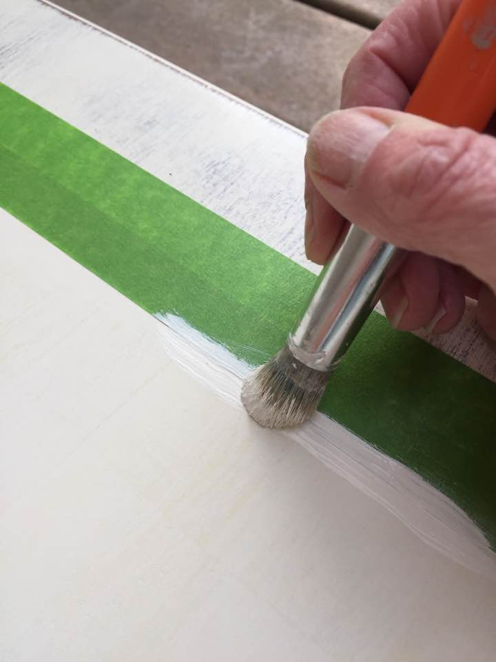 Apply a thin coat of paint to prevent it from seeping under the tape.