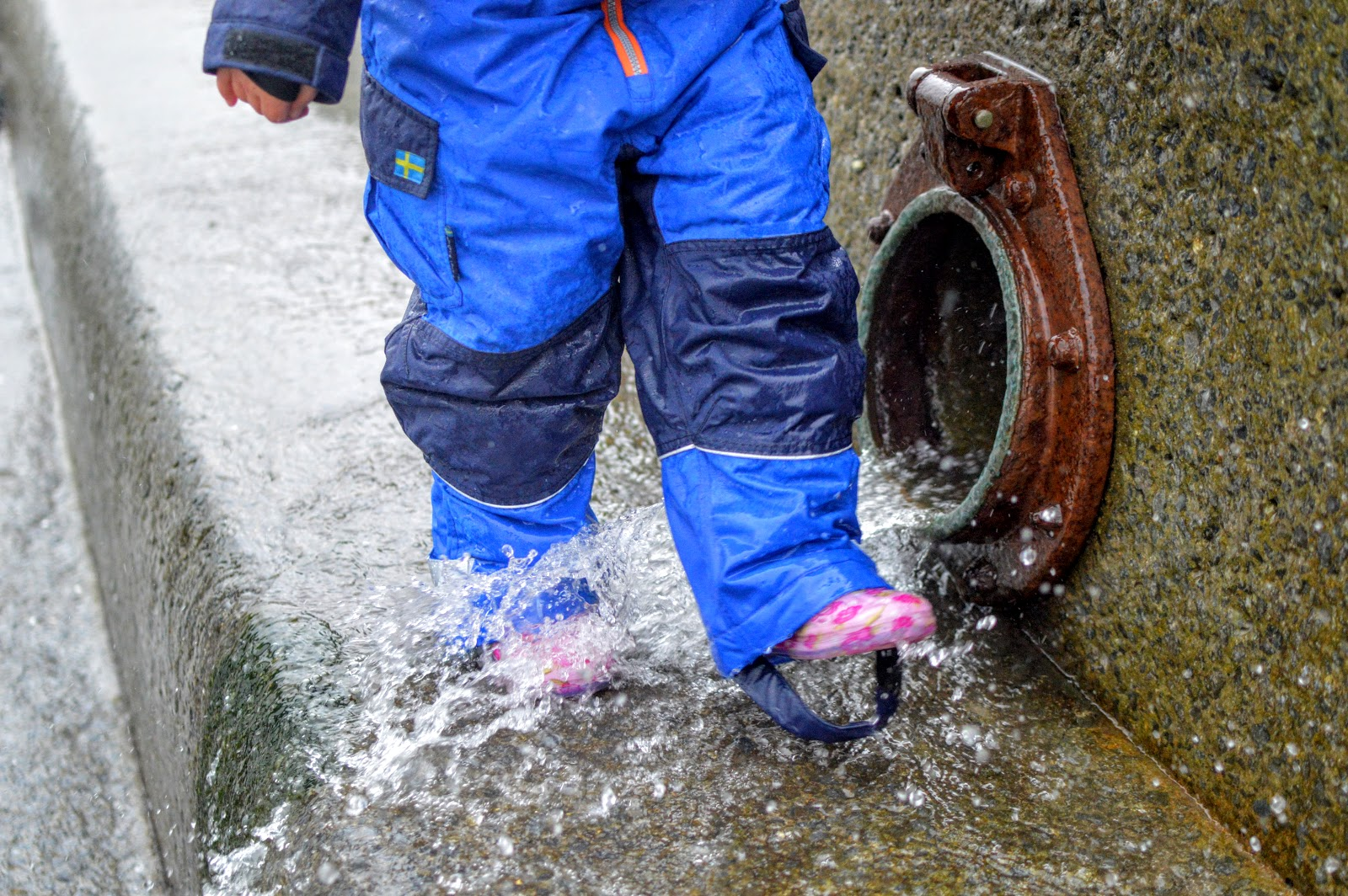 Wellies splashing in water