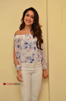 Actress Pragya Jaiswal Latest Pos in White Denim Jeans at Nakshatram Movie Teaser Launch  0038.JPG