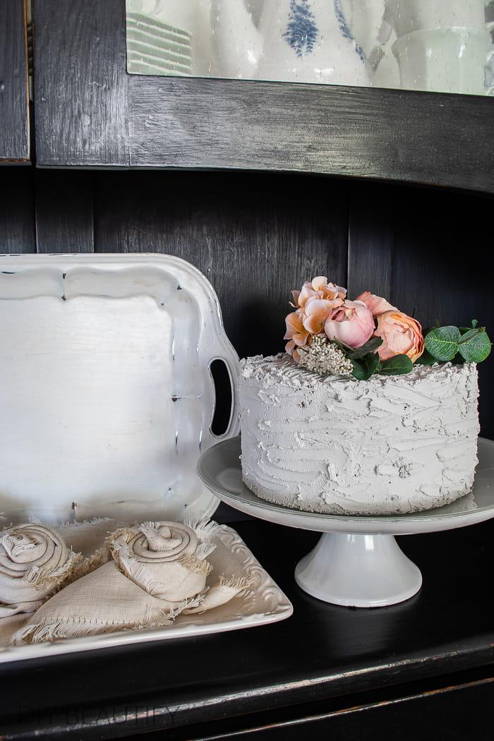 fake cake with pink peonies