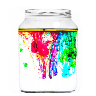Explore the science of liquid densities with this fun & magical experiment for kids!  My kids loved making fireworks in a jar and used this activity for their science fair project, too! #scienceactivities #scienceactivitiesforkids #fireworksinajar #fireworksinabottle #fireworkscraft #scienceexperimentskids #scienceforkids #sciencefairprojectsforelementary #sciencefairprojects