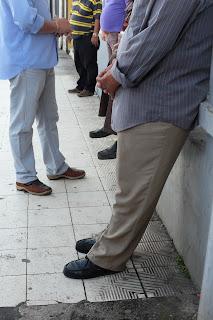Men's legs on sidewalk in Puriscal