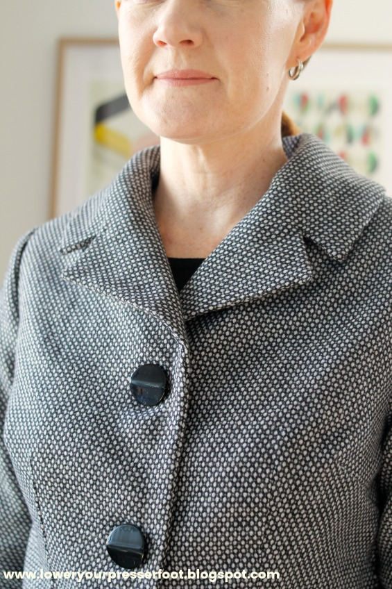 close up of a large collar on a ladies suit jacket