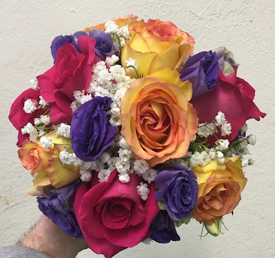 Colorful bridesmaid bouquet by Stein Your Florist Co. in Philadelphia, PA