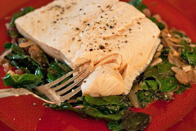 Poached salmon over sauteed greens