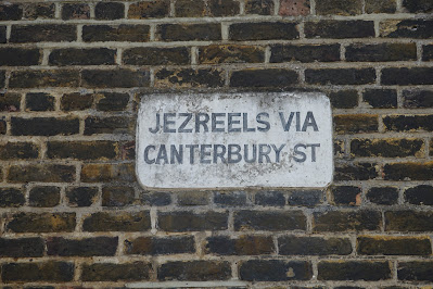 A similar sign saying 'JEZREELS VIA CANTERBURY STREET'