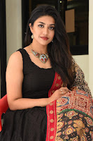 Telugu Actress Malavika Satheesan Photos in Churidar Dress at Bommala Koluvu Movie Trailer Launch. HeyAndhra.com