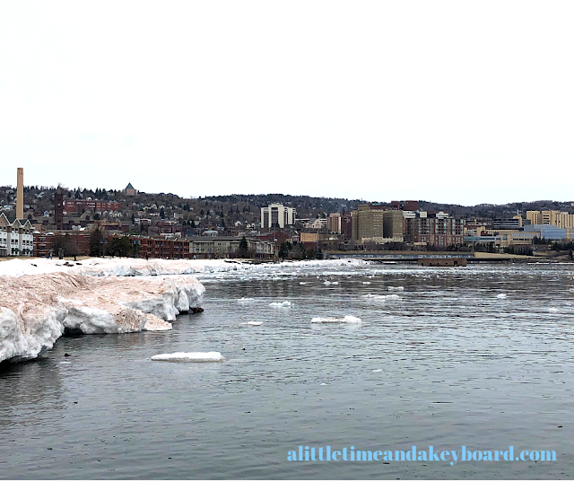Duluth perched above the almost entirely thawed Lake Superior.