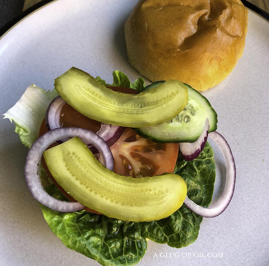 Adding salad to burger buns
