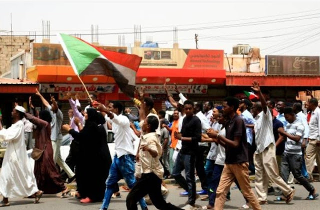 "Protesters in Khartoum in the 30 June protests from men, women and children ""AFP"""