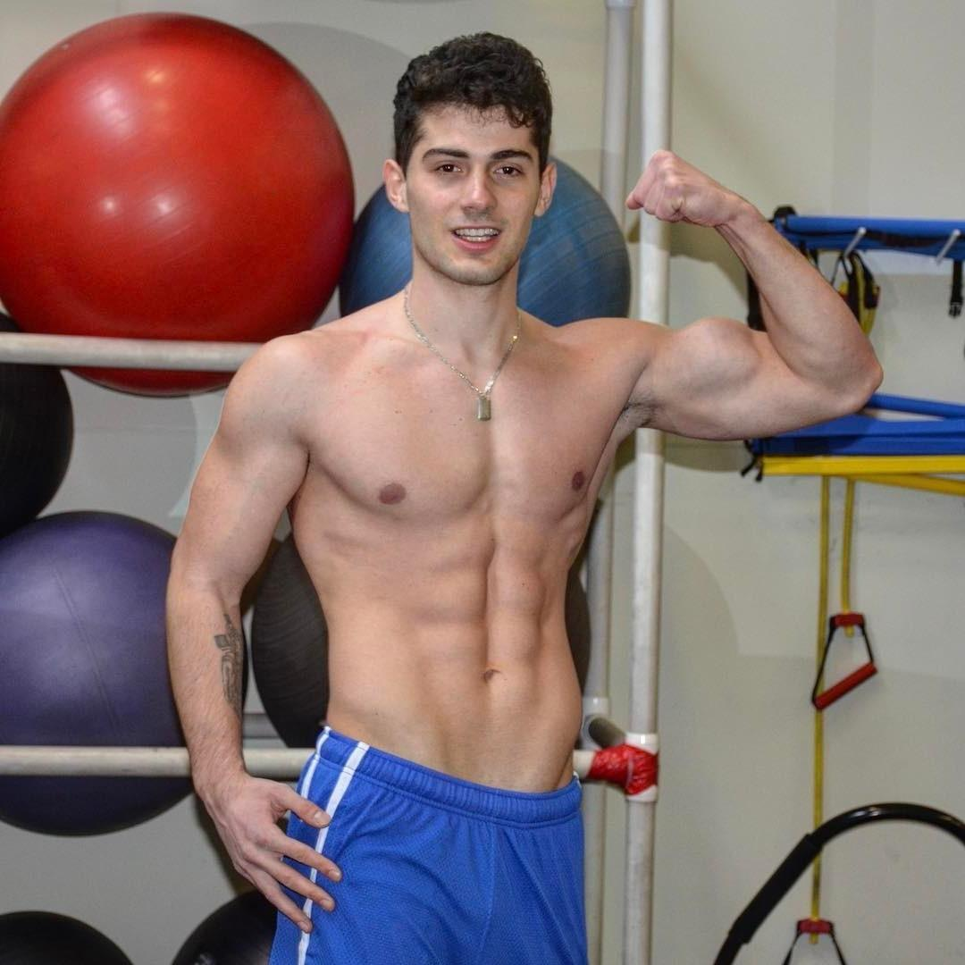 cute-college-bro-shirtless-fit-body-young-gym-hunk-fist-pump-biceps-abs