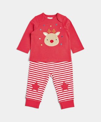 Pyjamas for babies from Mama and Papas with a red top with a reindeer face on and red and white striped trousers with a red star on the knees