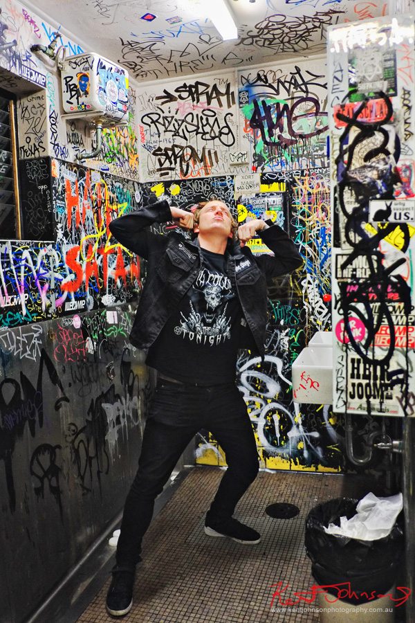 Black denim, hell themed photoshoot in a graffiti covered men's bathroom, Sydney Australia by Kent Johnson for Street Fashion Sydney.