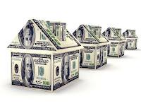 Mal varlığını anlatan kağıt dolar paralardan yapılmış evler