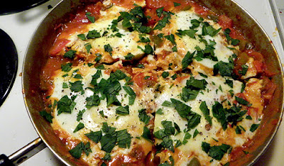 Finished Shakshuka in Skillet, cut into 4 pieces