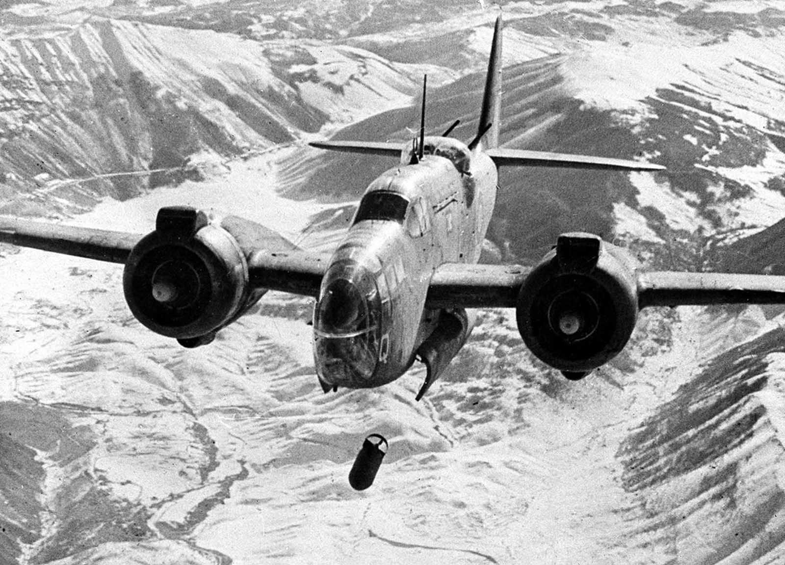 A Royal Air Force Baltimore light bomber drops a series of bombs during an attack on the railway station and junction at the snow-covered town of Sulmona, a strategic point on the east-west route across Italy, in February of 1944.