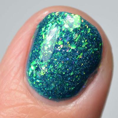 teal flakie nail polish close up swatch