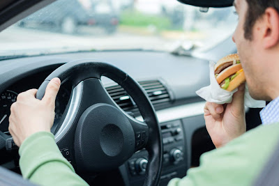 eating while driving car accident injury claim lawsuit attorney Florida