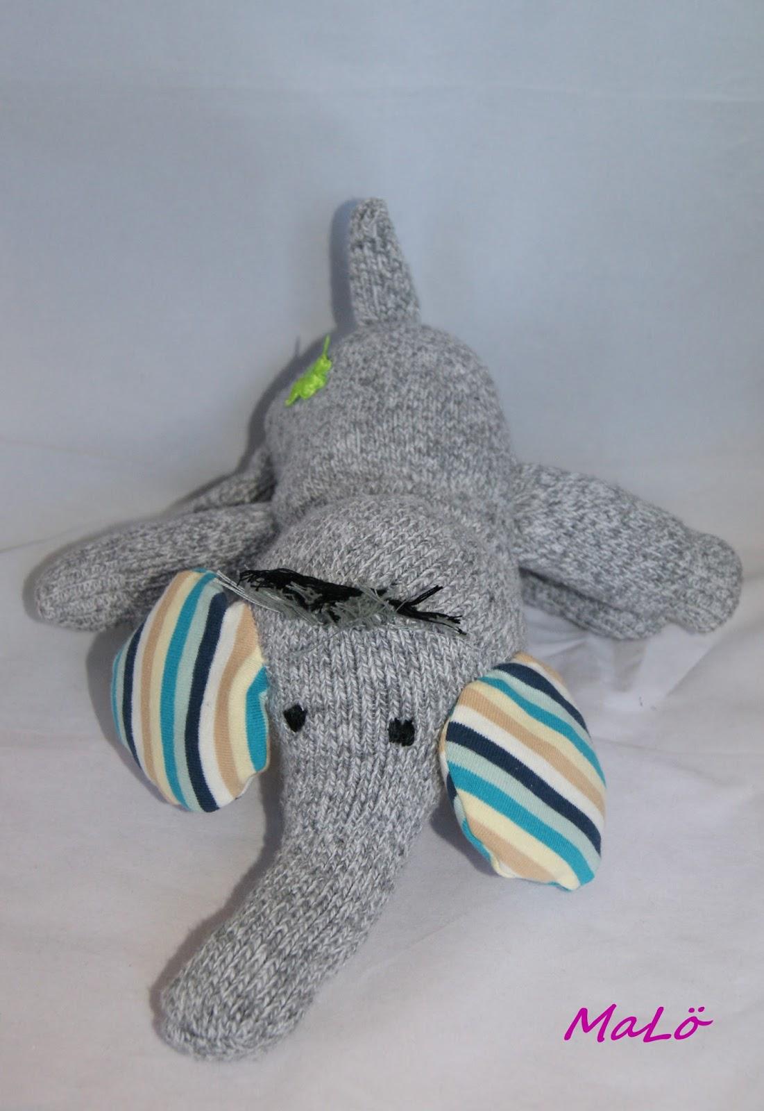 socken elefant mit sturmfrisur und kleeblatt am hintern. Black Bedroom Furniture Sets. Home Design Ideas