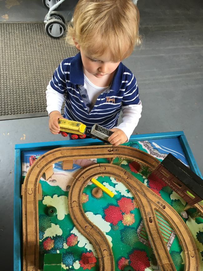 toddler-playing-with-wooden-train-at-perrygrove-railway