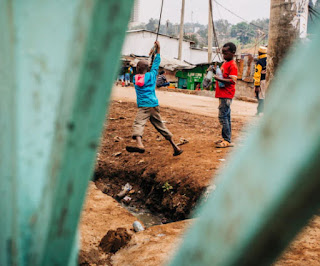Playing with a swing in Nigeria Africa.