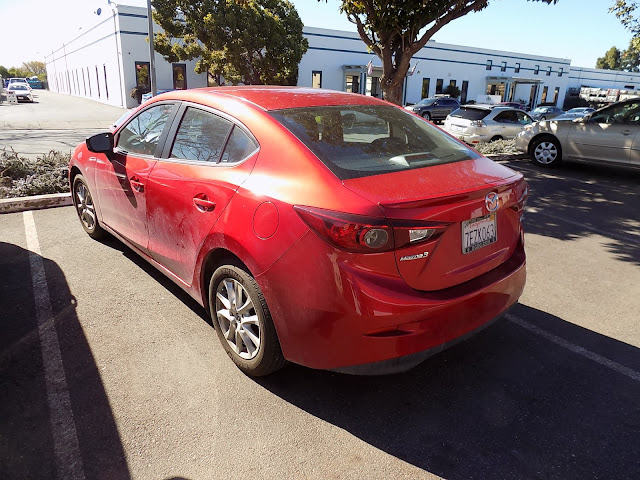 Mazda 3 color mis-match on 3-stage Soul Red paint before repairs at Almost Everything Auto Body.