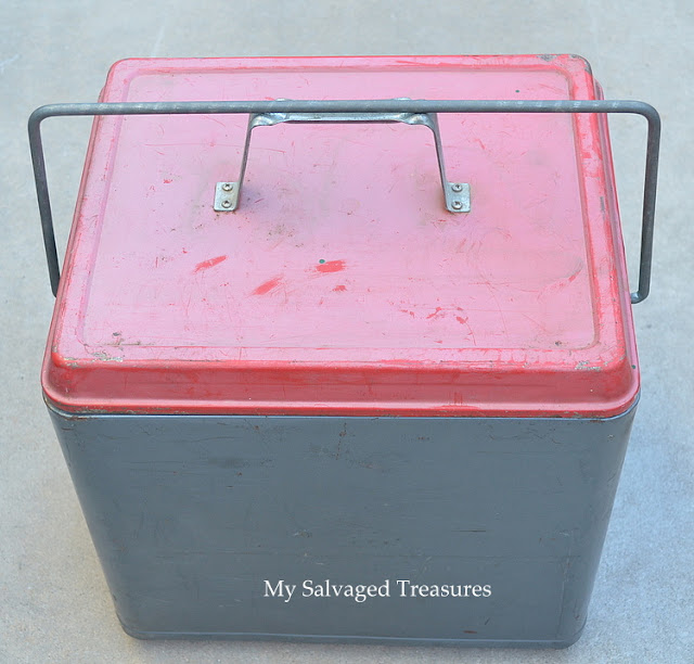 vintage ice chest with red lid