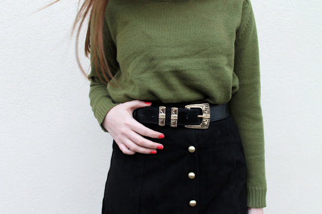 khaki green H&M jumper, western style belt and button down boohoo skirt with orange nails - 90s and 70s style mash up