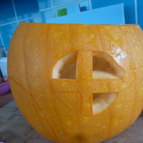 Orange Halloween pumpkin windows being carved