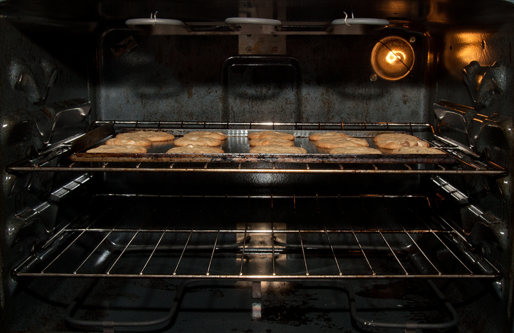 A tray of cookies baking in the oven.