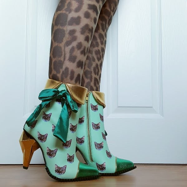 wearing green ankle boots with gold jewel diamond shaped heel and cat print