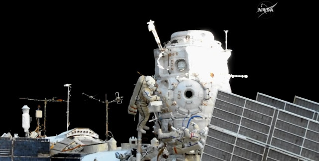 Fyodor Yurchikhin and Sergey Ryazanskiy gather around Pirs near the end of their spacewalk. Photo Credit: NASA