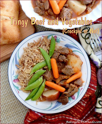 Tangy Beef and Vegetables (Crockpot or Not) is a lower in fat dinner. Beef, carrots, and potatoes are cooked all in one pan in a spicy, tangy sauce. | Recipe developed by www.BakingInATornado.com | #recipe #dinner