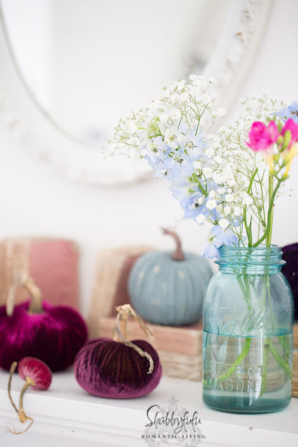 style a fireplace mantel with velvet pumpkins