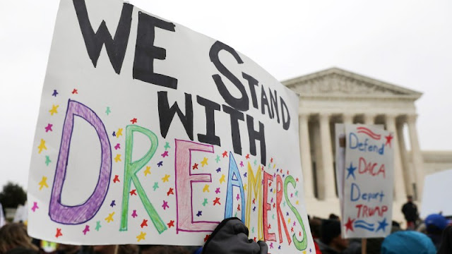 Image Attribute: Demonstrators rally outside the U.S. Supreme Court as justices were scheduled to hear arguments regarding the Trump administration's bid to end the Deferred Action for Childhood Arrivals (DACA) program in Washington, U.S., November 12, 2019. / Source: Jonathan Ernst/Reuters)