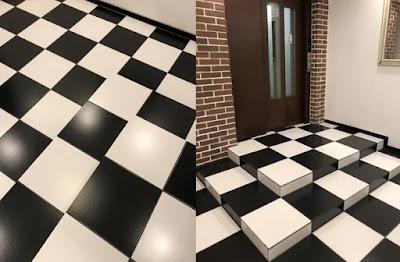 Stolperfalle Treppe - Baupfusch lustig - schwarz weiß karierte Fliesen