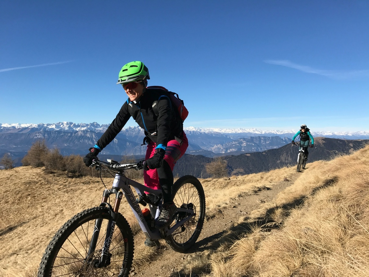 Cycling in Trentino. Elena Martinello on a mountain trail of Levico Terme