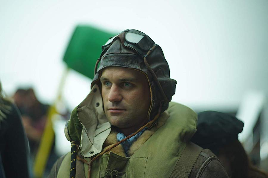 close up of world war 2 pilot wearing cap and oxygen mask for blog post about movie mission of honor