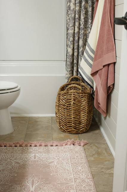 Use a small basket instead of a hamper in a small bathroom