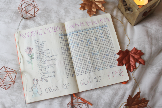 Bullet journal with habit tracker table on