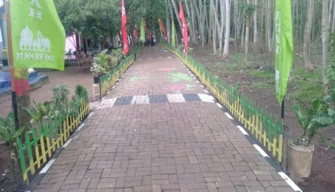 Desa Sukajadi Sukses Tata Kampung Berbunga Bersih dan Aman