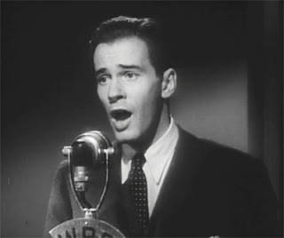 James (Richard Carlson) sings his way to fame and fortune in Beyond Tomorrow (1940)