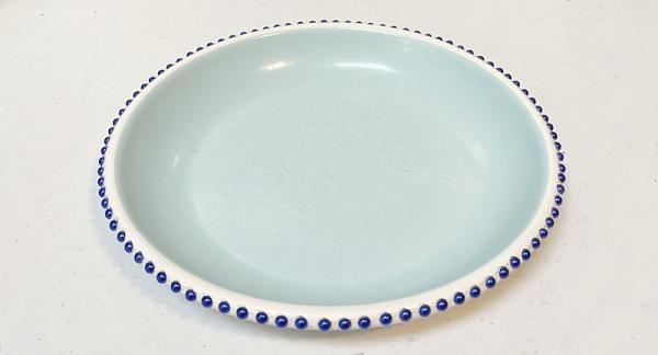 beads around the metal dish