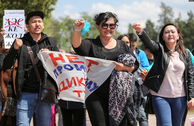 Image Attribute: The file photo of protestors' march through Almaty's Gorky Park on May 1, 2019,/ Source: Reuters