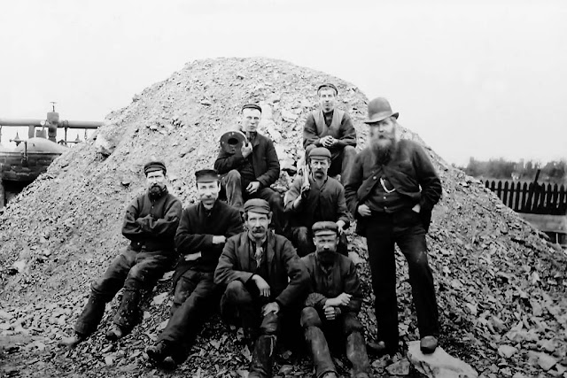 Workmen from Crowgarth Number 4 Pit, sat upon Slag